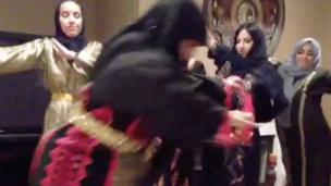 'People dressed up as arab grandmas dancing' from the web at 'http://ichef-1.bbci.co.uk/news/304/cpsprodpb/1360B/production/_86617397_screenshot2015-11-10at17.32.53.png'