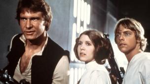 From left, Harrison Ford, Carrie Fisher, and Mark Hamill are shown in a scene from Star Wars