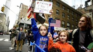 'Children thank veterans' from the web at 'http://ichef-1.bbci.co.uk/news/304/cpsprodpb/77F0/production/_86640703_030075380.jpg'