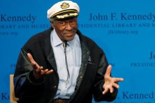 Chuck Berry gestures to the audience at the 2012 Awards for Song Lyrics of Literary Excellence awarded to both him and Leonard Cohen at the John F. Kennedy Presidential Library and Museum in Boston, Massachusetts February 26, 2012.