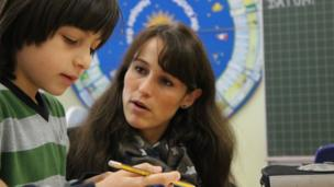 'Teacher and pupil in integration school' from the web at 'http://ichef-1.bbci.co.uk/news/304/cpsprodpb/955F/production/_86593283_svenja_and_pupi624l.jpg'