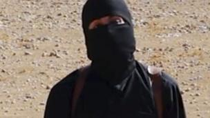 'Mohammed Emwazi - shown with a mask' from the web at 'http://ichef-1.bbci.co.uk/news/304/cpsprodpb/A3BE/production/_86681914_hi026072409-1.jpg'