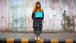 """A woman waits for the start of the #IWillGoOut rally, organized to show solidarity with the Women""""s March in Washington, along a street in New Delhi, India January 21, 2017"""