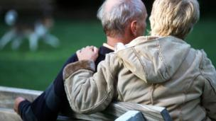 'Older couple on a park bench - posed by models<div style=