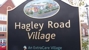 'Hagley Road village sign' from the web at 'http://ichef-1.bbci.co.uk/news/304/cpsprodpb/E85E/production/_86668495_p1040721.jpg'