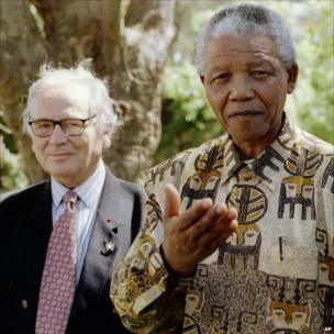 Nelson Mandela asks journalists what they think of his shirts after a lunch with fashion designer Pierre Cardin