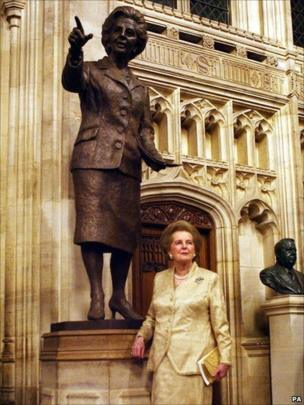 Baroness Margaret Thatcher stands in front of a bronze statue of herself, inside the Palace of Westminster, London