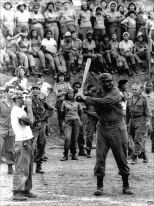 Fidel Castro takes his turn at bat during a baseball game held at a teachers school in the Sierra Maestra area of Cuba