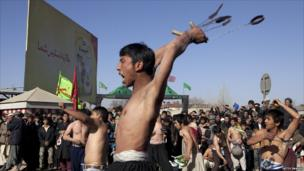 Shia muslims mark the Day of Ashura by striking themselves with knives