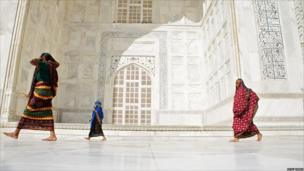 Women walk around the Taj Mahal, Agra.