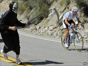 Spectator dressed as Grim Reaper at cycling road race