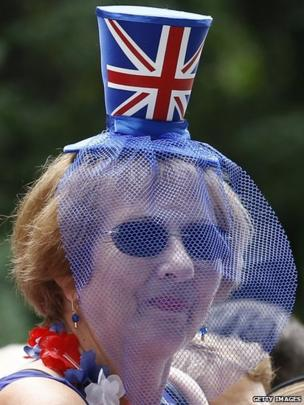 Woman wearing a hat with a Union Jack on it