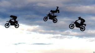 Motorcyclists from The Extreme Stunt Show take part in a performance at Earsdon, North Tyneside, during their UK tour.