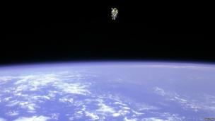 Astronaut on a space walk with Earth below him