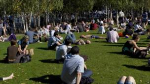 People relaxing on grass on the in London