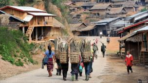 Villagers carry wood