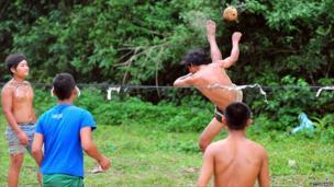 A man kicks the ball in a game of Kataw