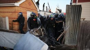 Riot police break through fencing on 19 October