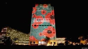 """An office block lit up with words """"your best way to REMEMBER"""""""