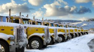 Lorries lined up in the snow