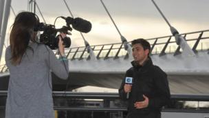 Ricky being filmed by bridge