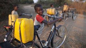 Canadians Donating Bikes To Africa Boy with bicycle in Chongwe