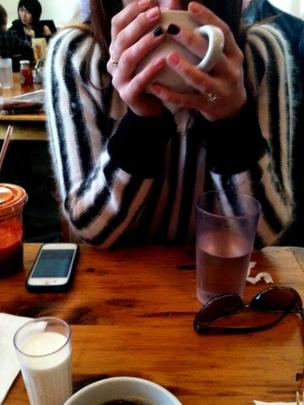 A woman drinking coffee in a cafe
