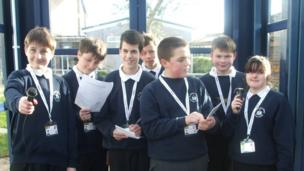 The class of 9A from St Anthony's School in Chichester stand together with their microphones and School Report passes in preparating for a busy day of reporting