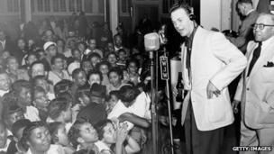 Alan Freed appears on stage the night of the Moondog Coronation Ball in Cleveland on 21 March 1952