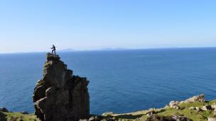 Climber on sea cliffs in Skye