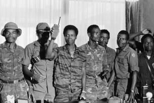 "Master Sgt. Samuel K. Doe, Liberia new chief of state, flourished walkie-talkie radio, as he posed with members of the ruling ""People's Redemption Council,"" shortly after the April 12, 1980 overthrow of President Willium R Tolbert Jr."