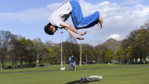 Sam doing a somersault