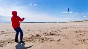 Jack flying his kite on St Cyrus beach
