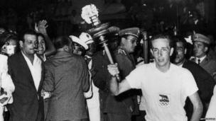 The Olympic flame arrives in Rome for the opening ceremony of the Rome Olympics, 25th August 1960.