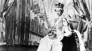 Queen Elizabeth II poses with the royal sceptre 02 June 1953 after being crowned solemnly at Westminter Abbey in London. Elizabeth was proclaimed Queen in 1952 at age 25.
