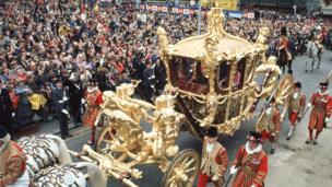 Queen Elizabeth II arrives at St Pauls Cathedral, in the Gold State Coach, for a ceremony marking her Silver Jubilee.