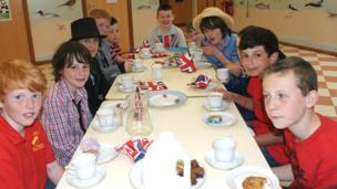 Boys at Killermont Primary School eating cake at school tea party