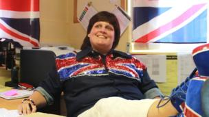 Colne Primet High School Exams Officer Emma Bannister dressed up in red, white and blue clothing