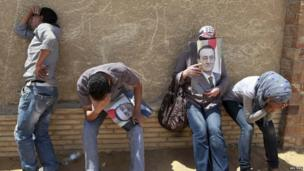Supporters of deposed President Hosni Mubarak react after a court sentenced him to life in prison