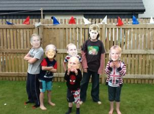 Children wearing Royal family face masks