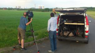 Joe and cameraman Marty film the Didcot Power Station towers in Oxfordshire.