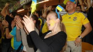 Ukraine fans cheer and smile