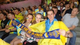 Ukraine students hold their Ukraine football scarf