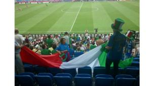 Italian fan with flag before kick-off