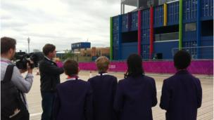 School Reporters look up at the BBC Studio