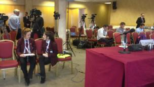 Reporters practising their questions inside the press room