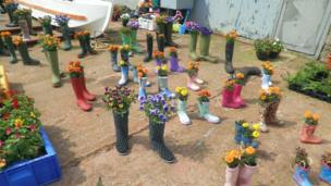 Wellington boots filled with flowers