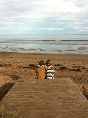 Mollie and Murray sitting on the beach