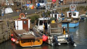 Fishermen in Crail harbour