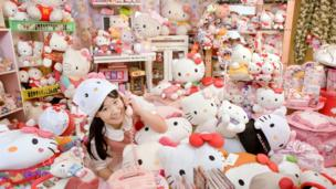 Japanese girl pictured with her record breaking Hello Kitty collection.